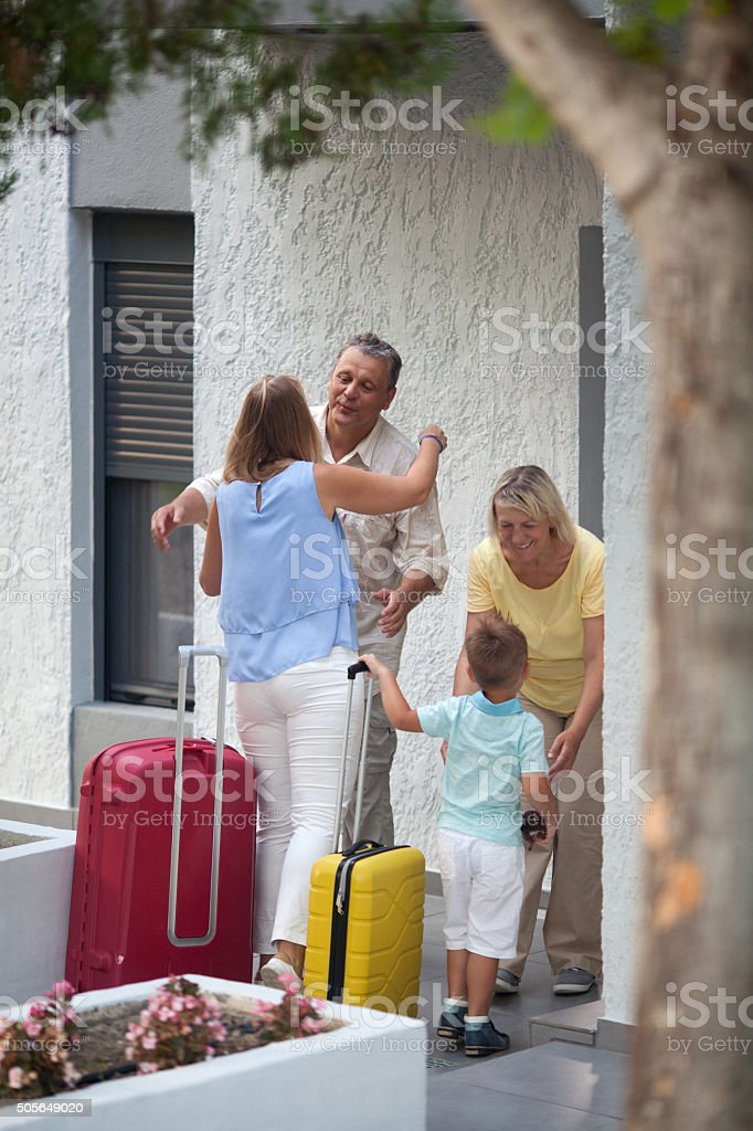 Happy parents meeting daughter and grandson stock photo