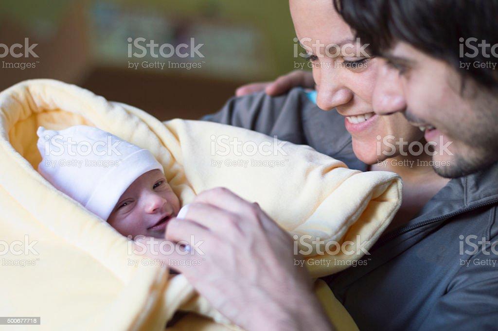 Happy parents with newborn baby stock photo