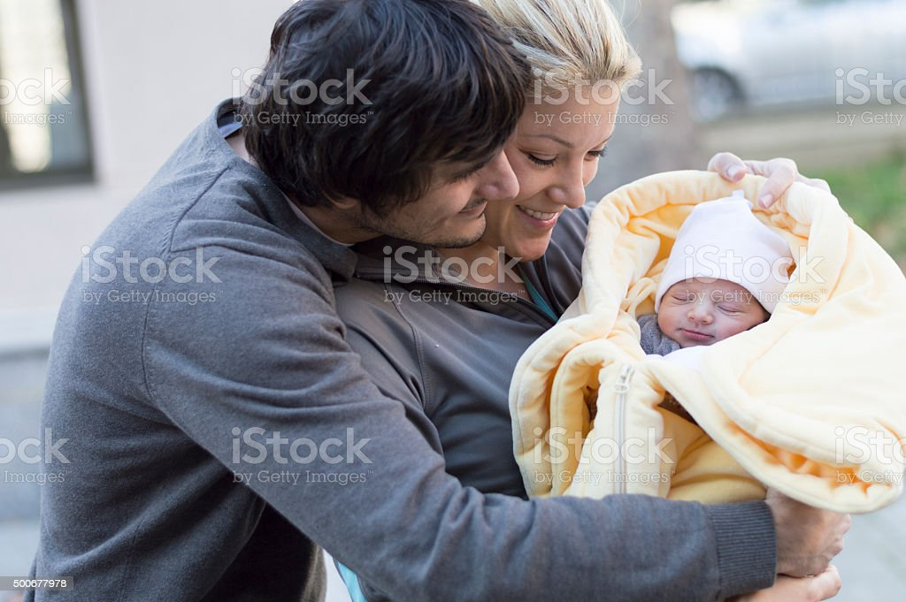 Happy parents with newborn baby stock photo