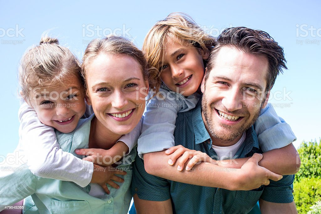 Happy parents with their children stock photo