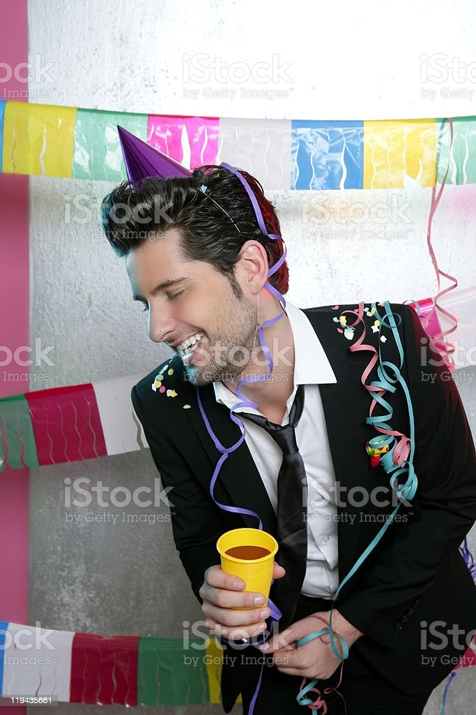 Happy party young man drinking enjoying alone royalty-free stock photo