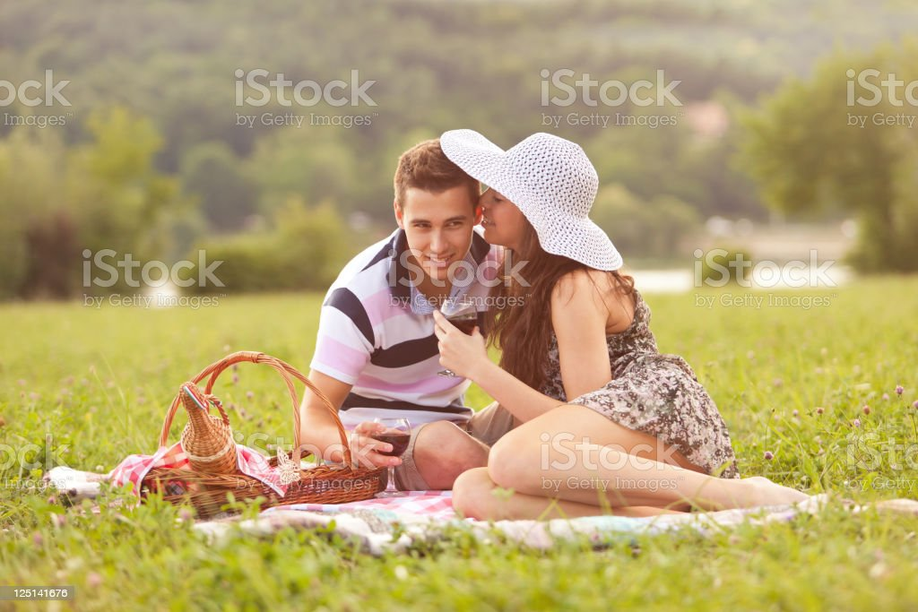 Happy passionate couple spending time together on a picnic stock photo