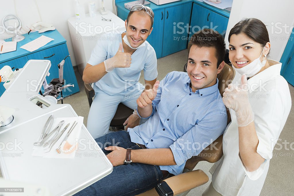 Happy patient and dentists royalty-free stock photo