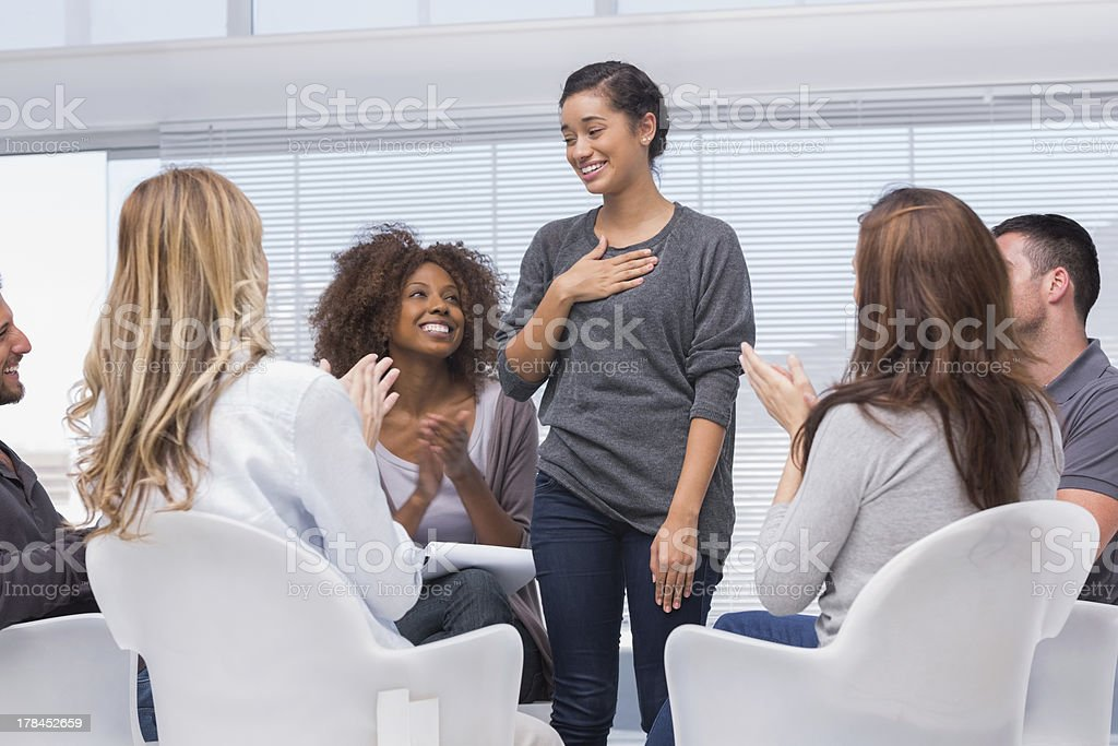 Happy patient has a breakthrough in group therapy stock photo