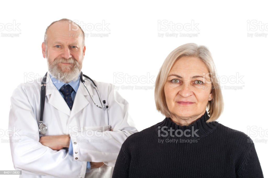 Happy patient with her doctor stock photo