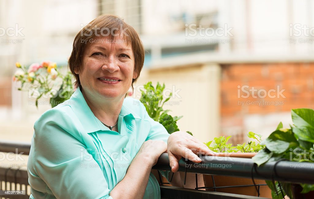 Happy pensioner woman relaxed on teracce stock photo