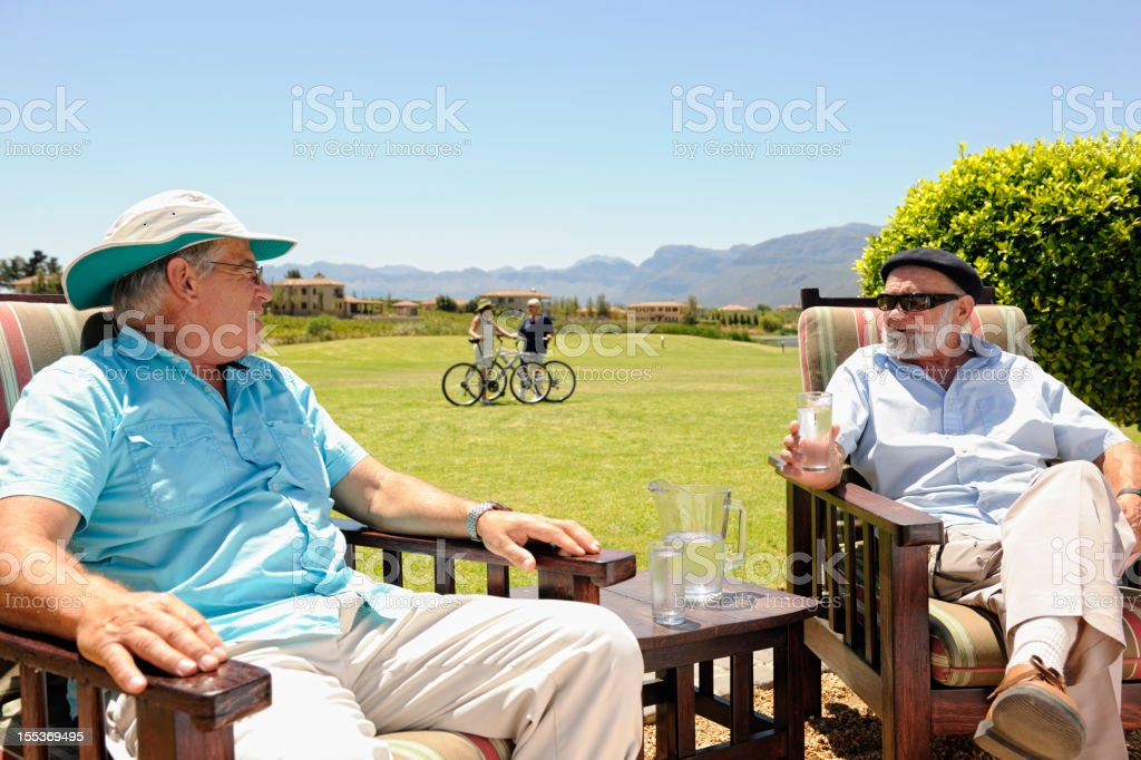 Happy Pensioners Spending Time in Upscale Resort stock photo