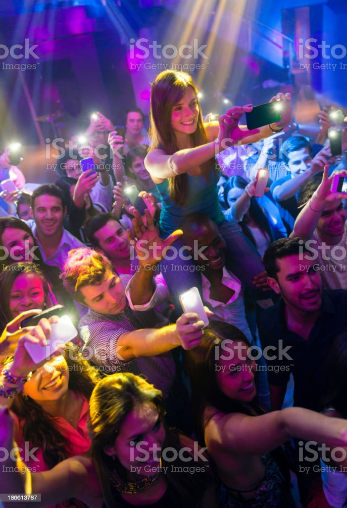 Happy people at a concert royalty-free stock photo
