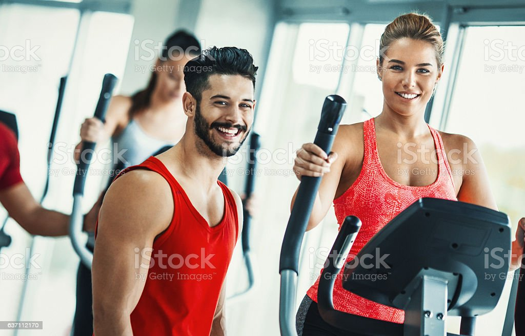 Happy people at a gym. stock photo