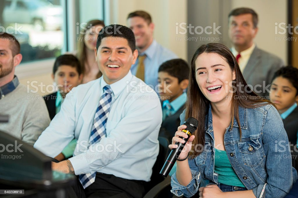Happy people at conference meeting stock photo