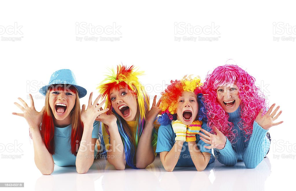 Happy people doing antics, wearing colorful wigs. royalty-free stock photo
