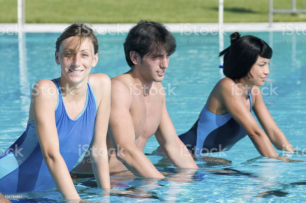 Happy people exercising with water aqua bike royalty-free stock photo
