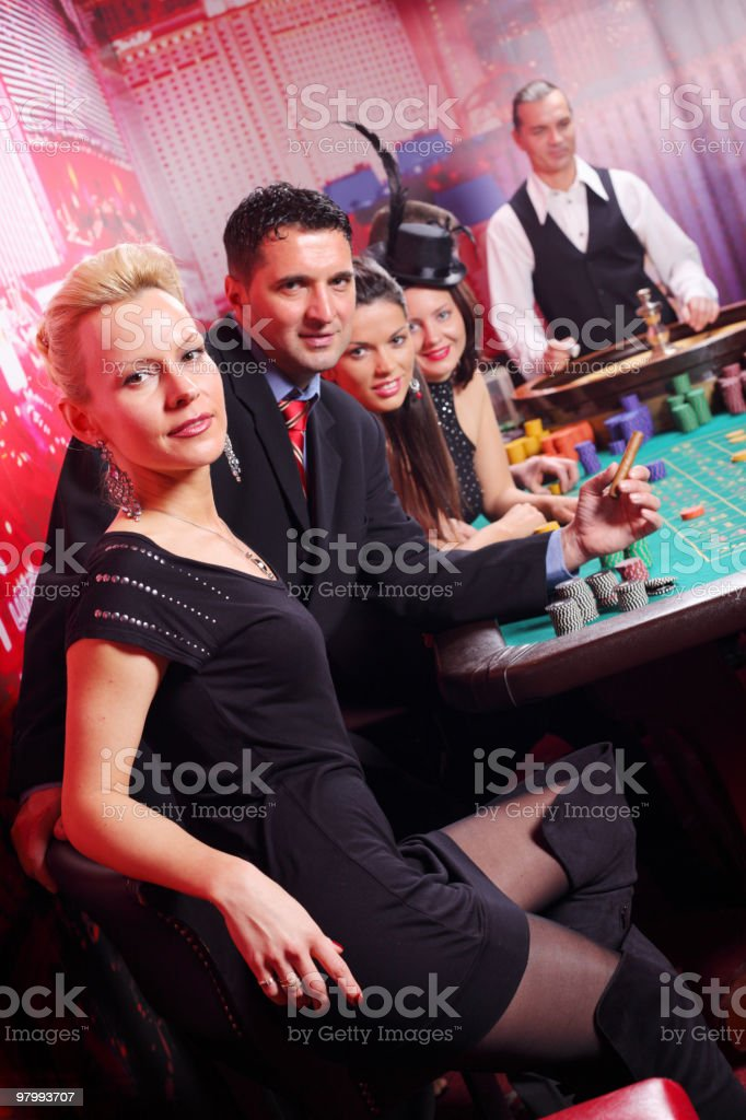 Happy people have a good time in casino. stock photo