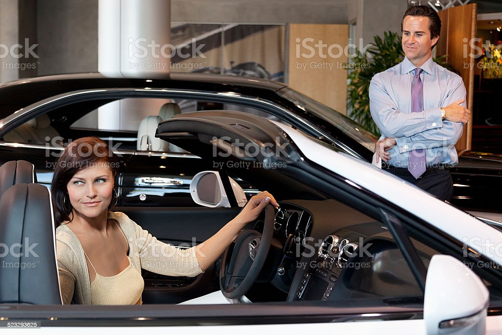 Happy people in a Car showroom stock photo