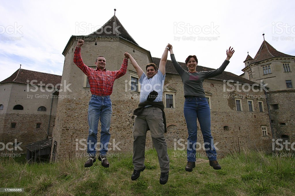 Happy People Jump at Fagaras Castle Transylvania Romania royalty-free stock photo