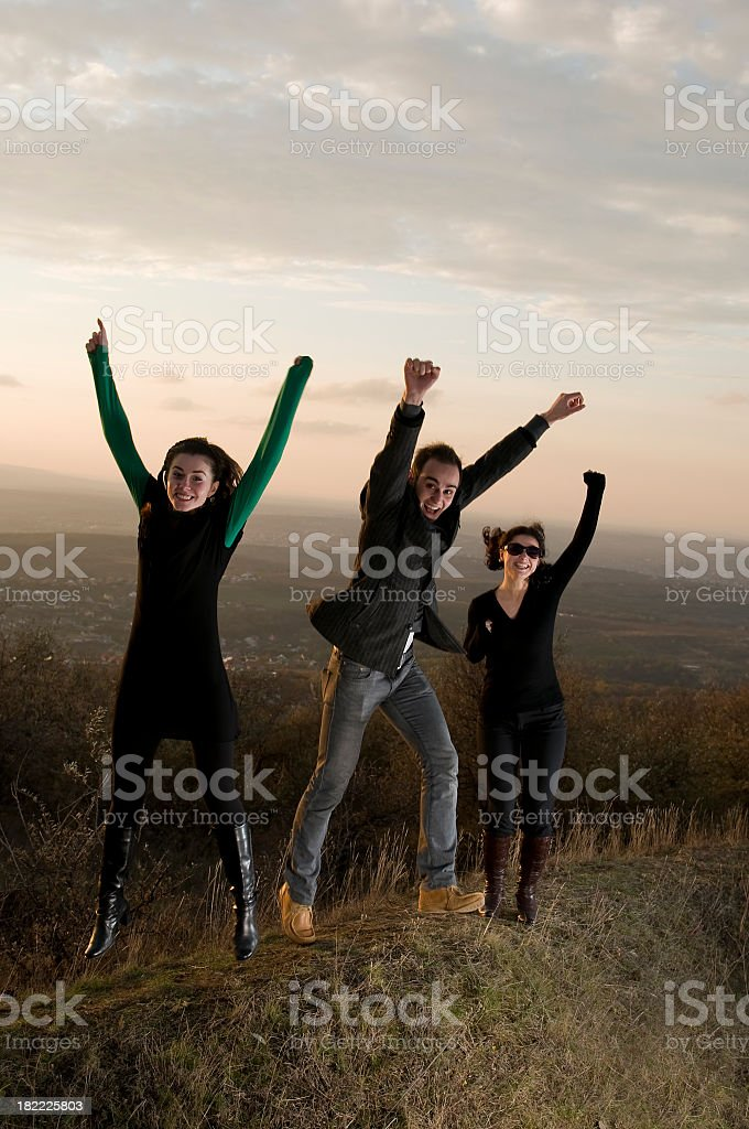 Happy people jumping up royalty-free stock photo