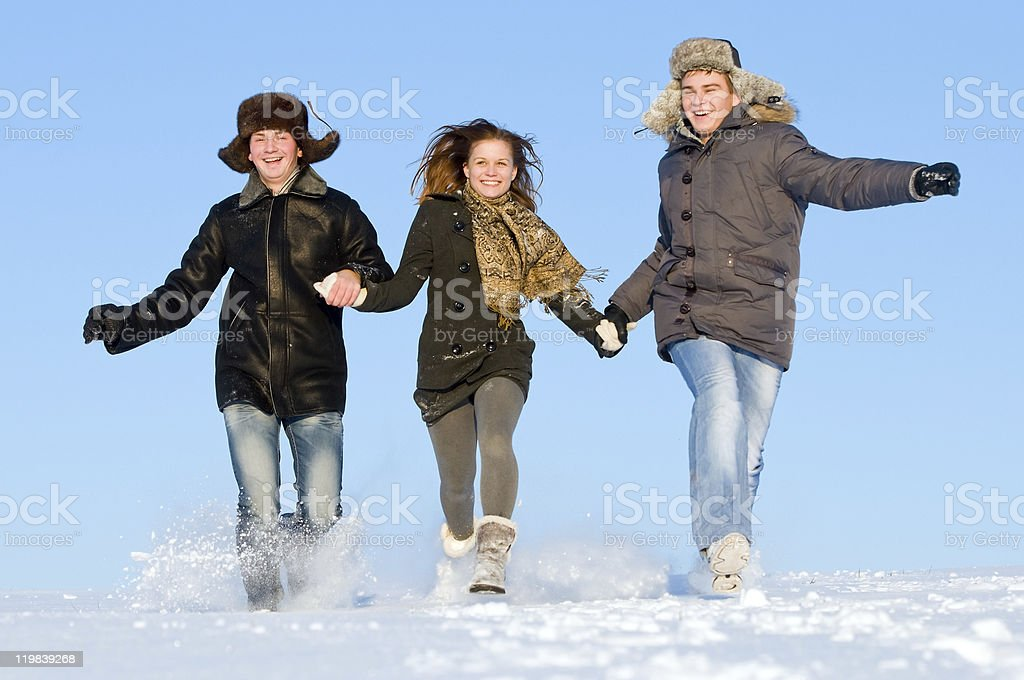 happy people running in winter royalty-free stock photo