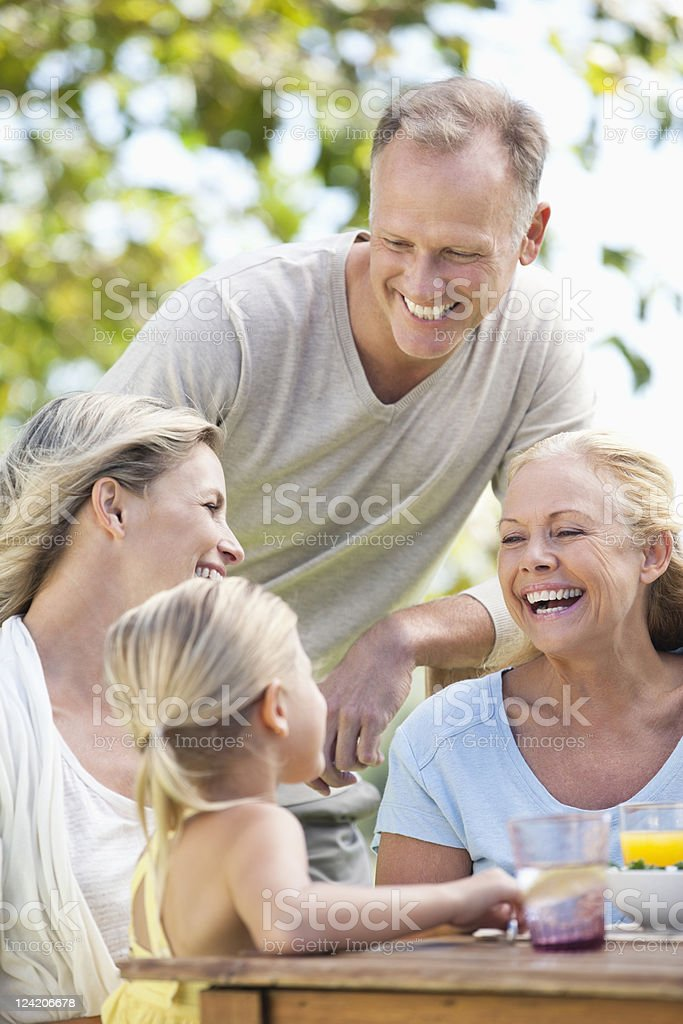 Happy people with kid enjoying breakfast together royalty-free stock photo