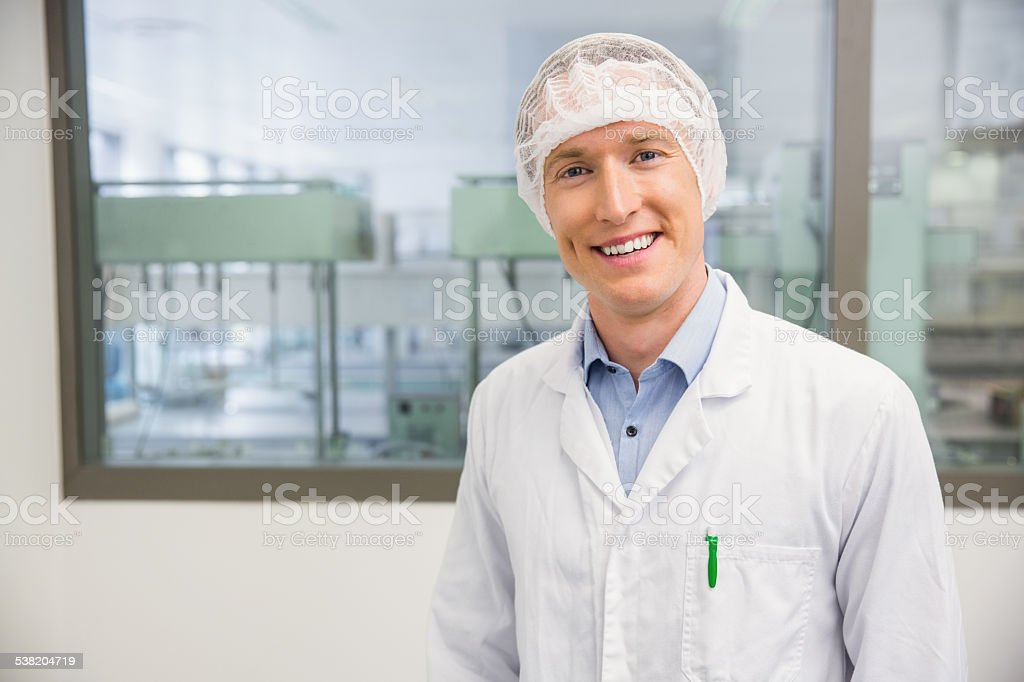 Happy pharmacist in a hairnet stock photo