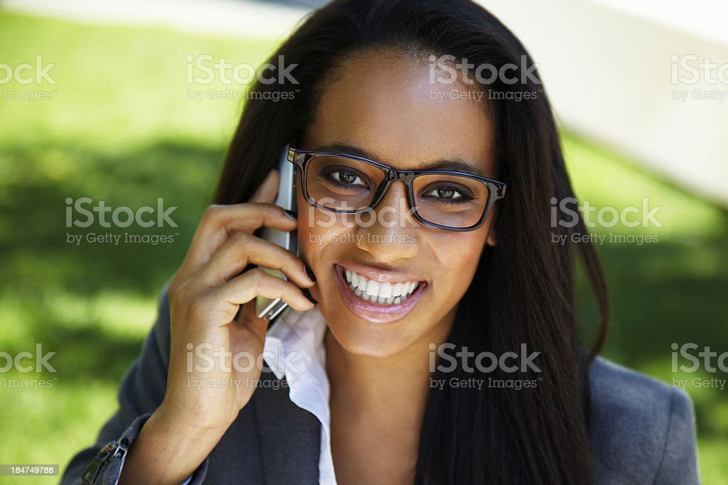 Happy Phone african businesswoman - outdoors royalty-free stock photo