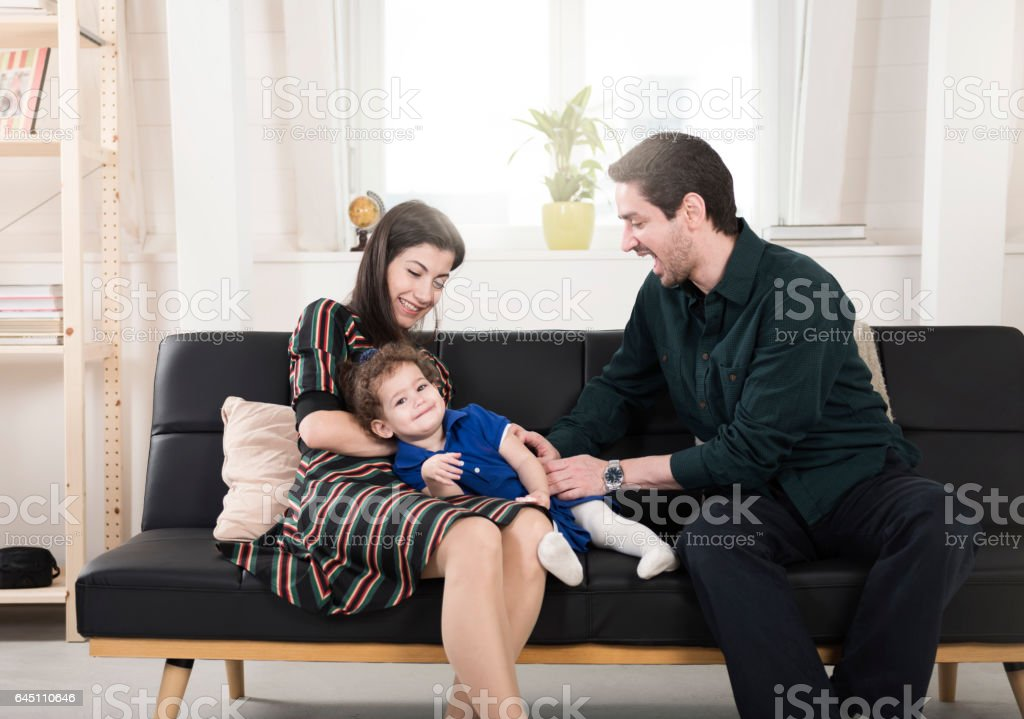 Happy playful family having fun at home stock photo