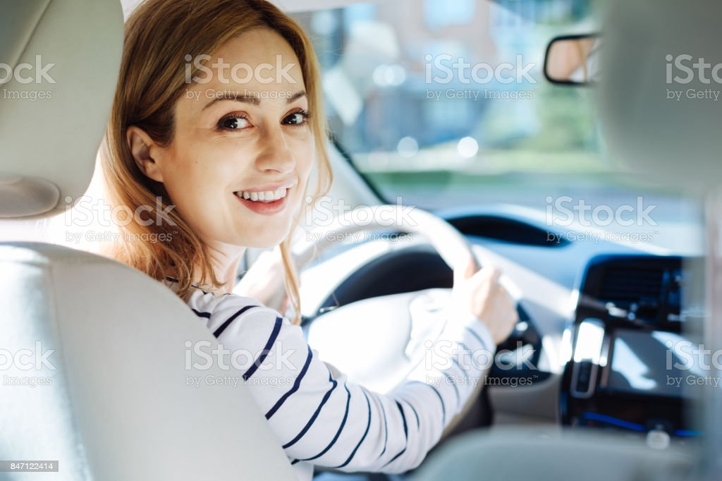 Happy pleasant woman turning to you stock photo