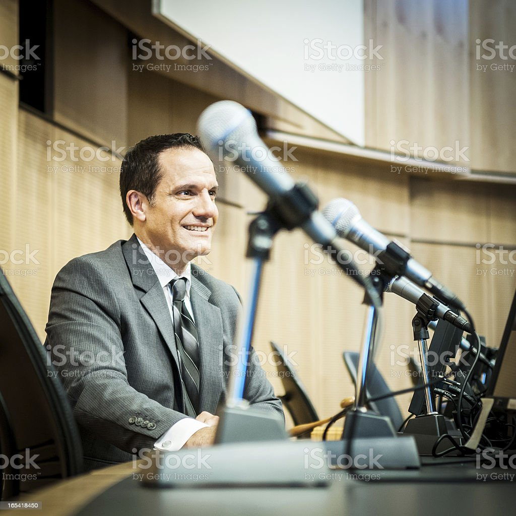 Happy Politician at the auditorium stock photo