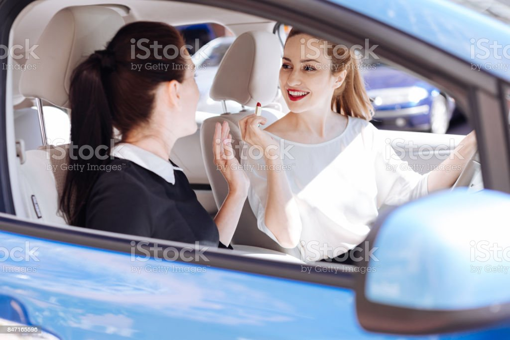 Happy positive woman talking to her friend stock photo