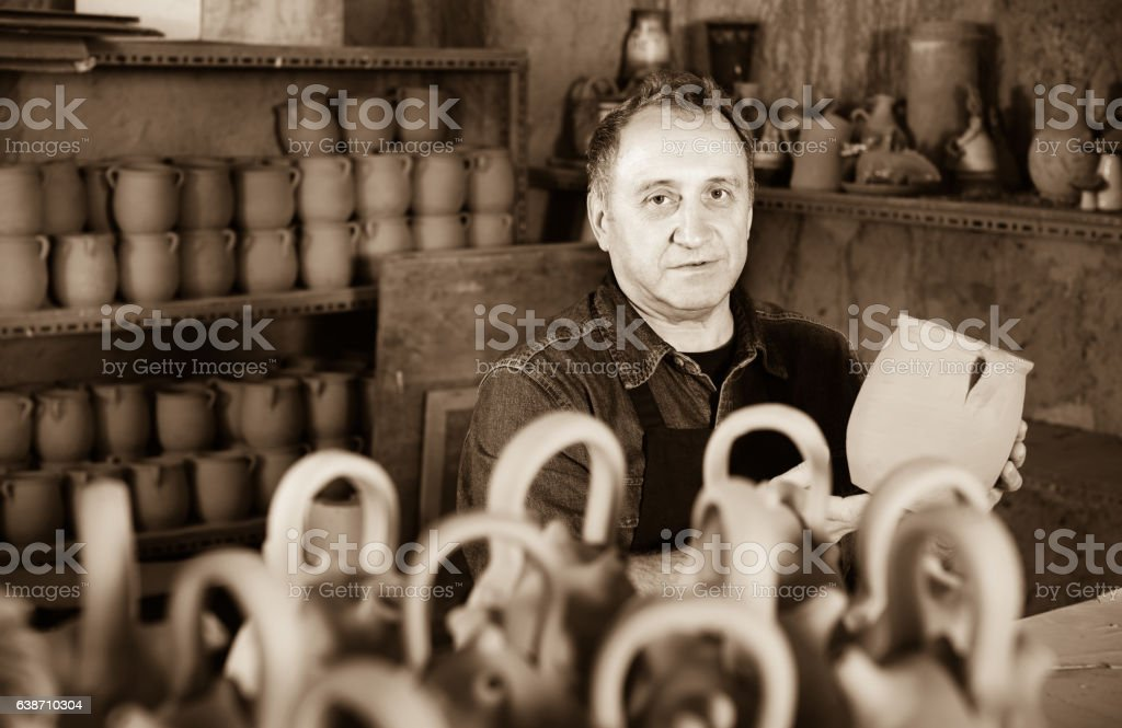 Happy potter at the workshop stock photo