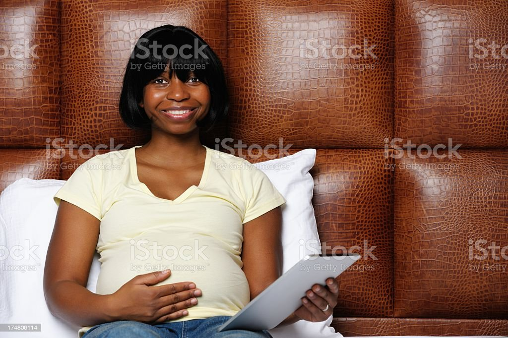 Happy Pregnant Relaxing In Bed royalty-free stock photo