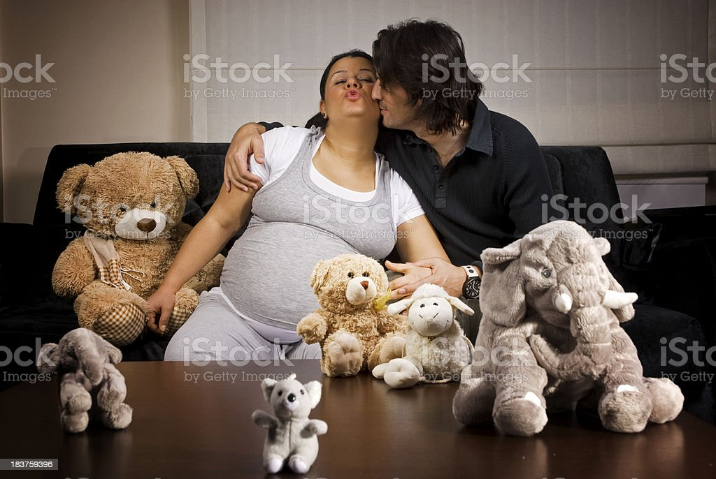 Happy pregnant wife and husband at home stock photo