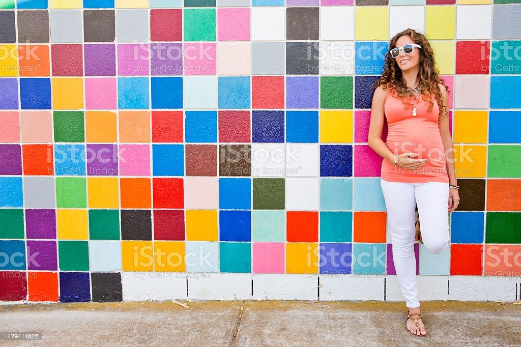 Happy Pregnant Woman in Bright Colors stock photo