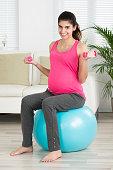 Happy Pregnant Woman Lifting Dumbbells