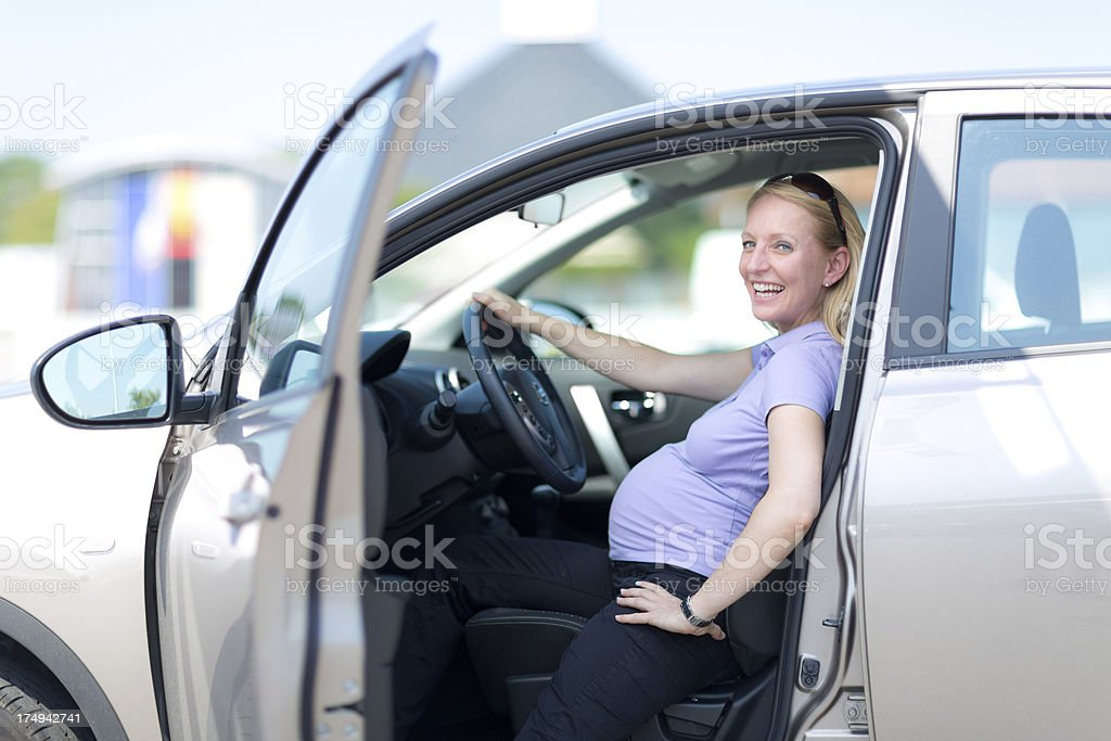 happy pregnant woman sitting in car royalty-free stock photo