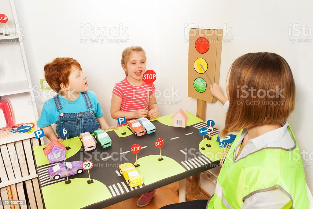 Happy preschool kids at the road safety lesson stock photo