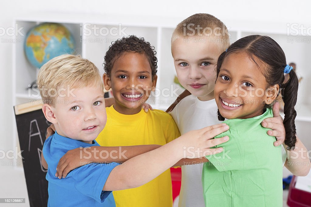 happy preschool kids hugging stock photo