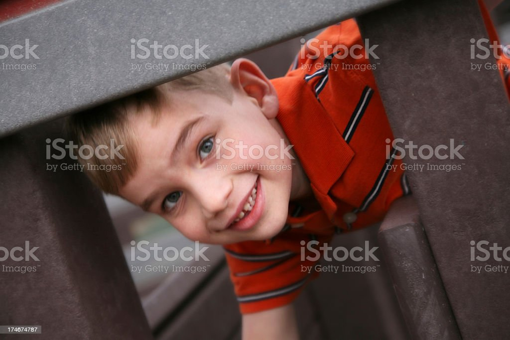 Happy Preschooler at a Playground looking out royalty-free stock photo