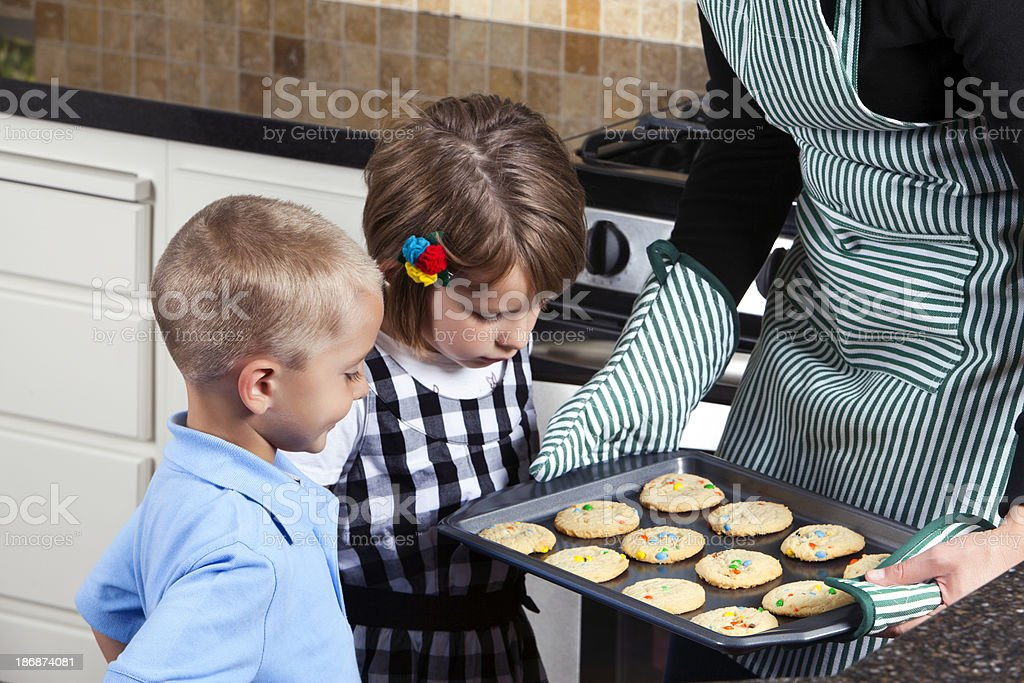 happy pretty mom baking holiday cookies royalty-free stock photo