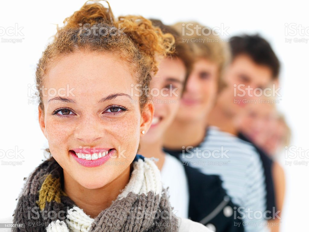 Happy pretty young woman with friends in the background royalty-free stock photo