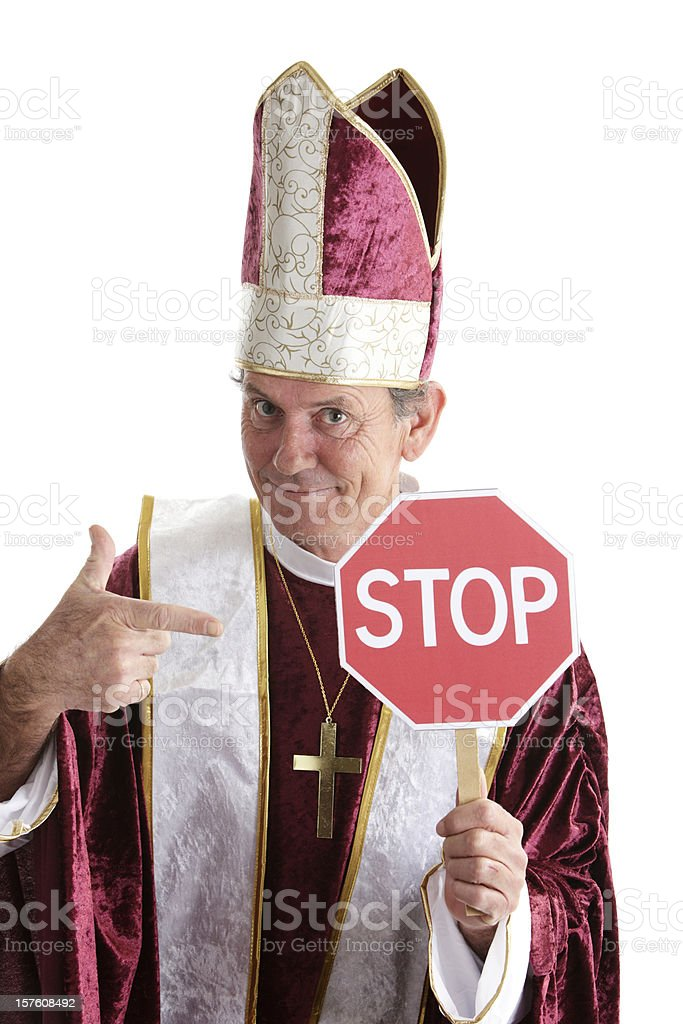 Happy Priest With a Stop Sign royalty-free stock photo