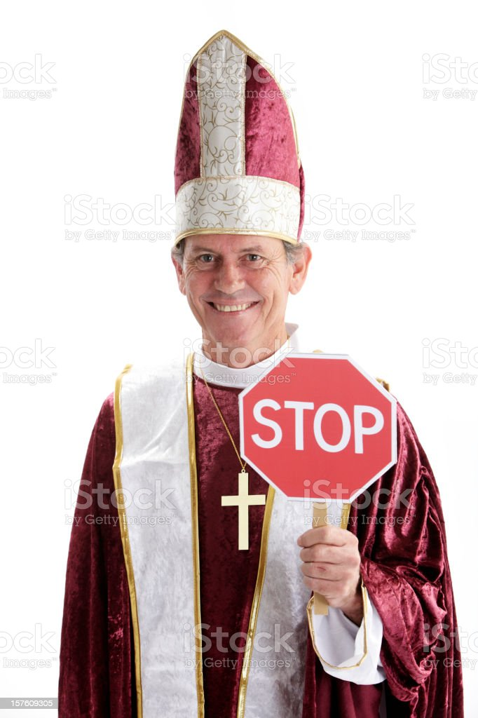 Happy Priest With Stop Sign stock photo