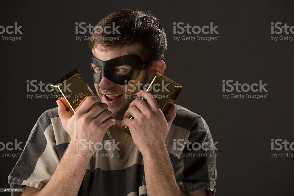 Happy Prisoner holding bars of gold royalty-free stock photo