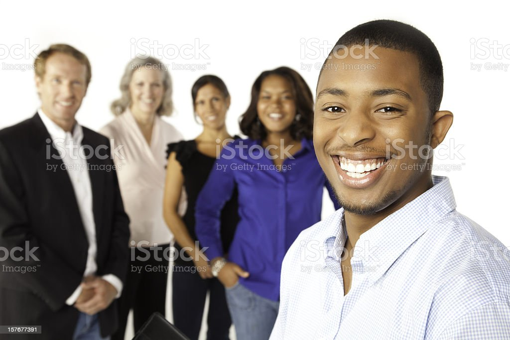 Happy Professional Businessman With Other People in Background royalty-free stock photo