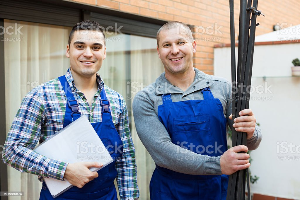 Happy professional workers in uniform stock photo