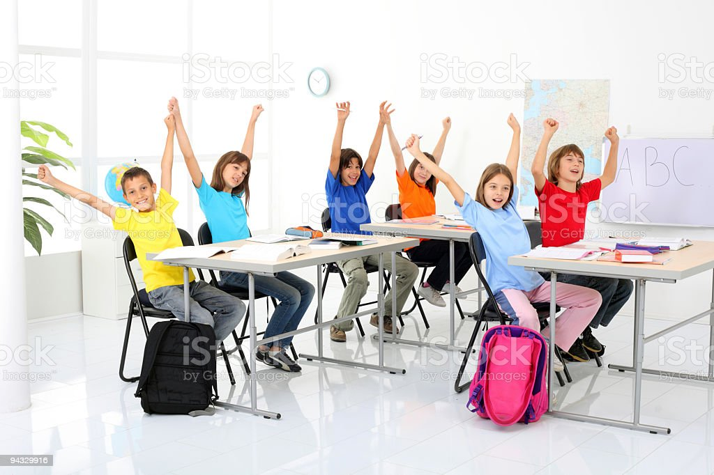 Happy pupils with hands raised up. royalty-free stock photo