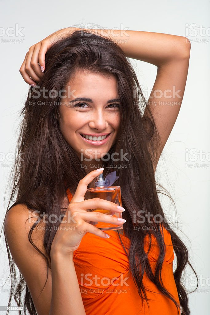 Happy quean in orange shirt is laughing. stock photo