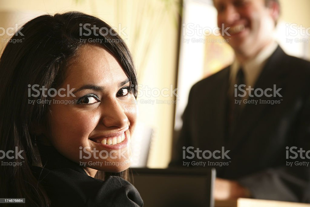 Happy Receptionist Welcoming a Client to the Office royalty-free stock photo