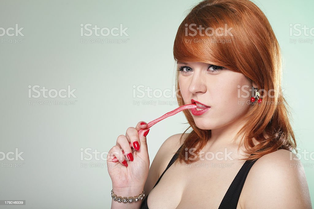 happy redhair woman with gummy candy royalty-free stock photo