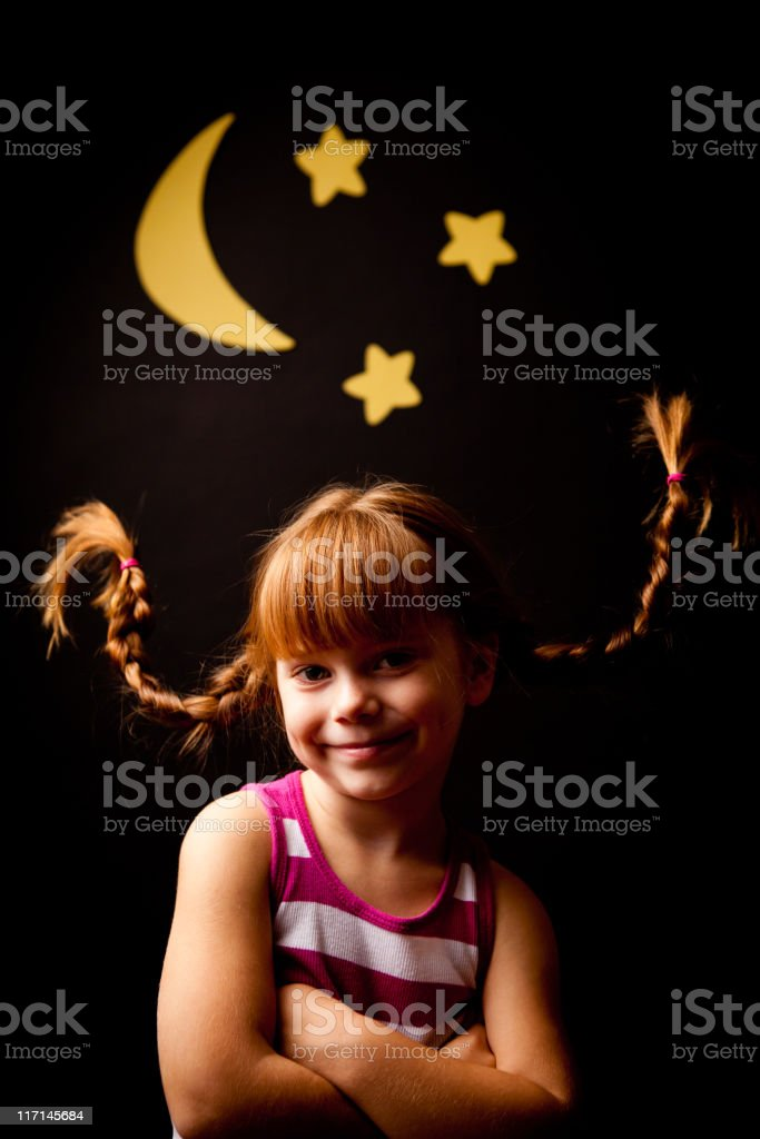 Happy, Red-Haired Girl with Upward Braids Smiling Under Moon stock photo