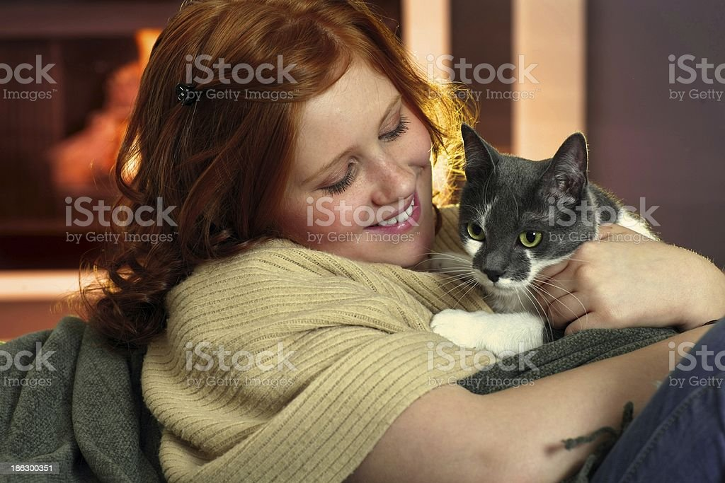 Happy redhead girl with cat stock photo